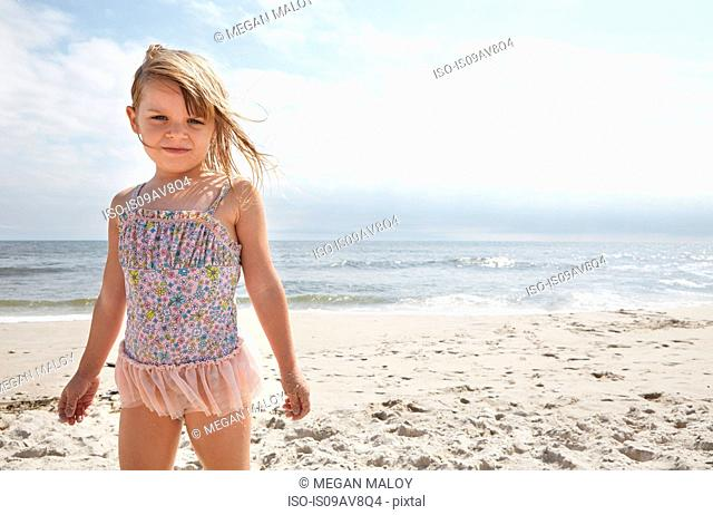 Girl standing on sandy beach, Holgate, New Jersey, US
