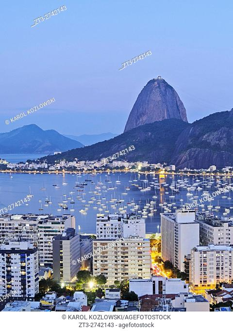 Brazil, City of Rio de Janeiro, Twilight view over Botafogo Neighbourhood towards the Sugarloaf Mountain