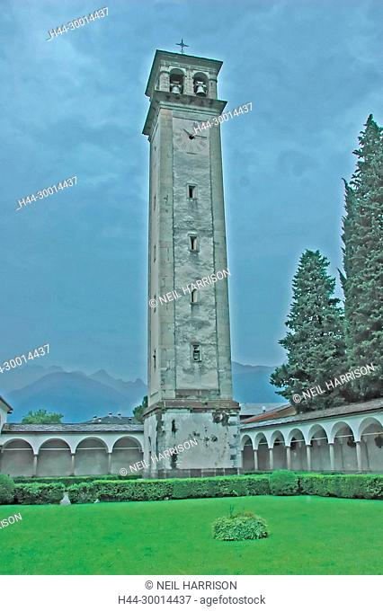 The old clock tower of St Lorenzo at Chiavenna in northern Italy. With the cloister in the foreground, on a stormy day