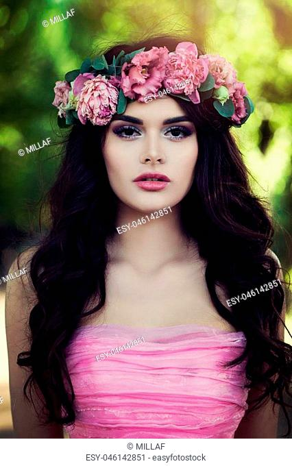 Perfect Brunette Model wearing Pink Dress with Flowers Outdoors