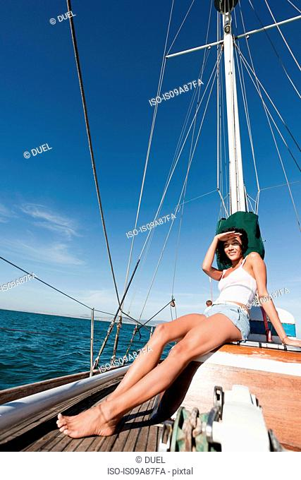 Young woman on deck of yacht