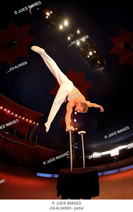 Male acrobat balancing at circus