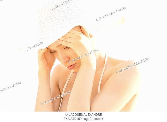 Woman headache at beach