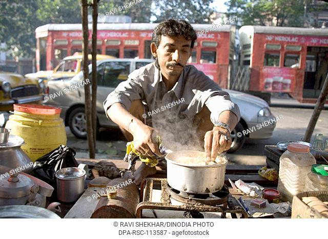 Tea vendor preparing tea ; Calcutta now Kolkata ; West Bengal ; India