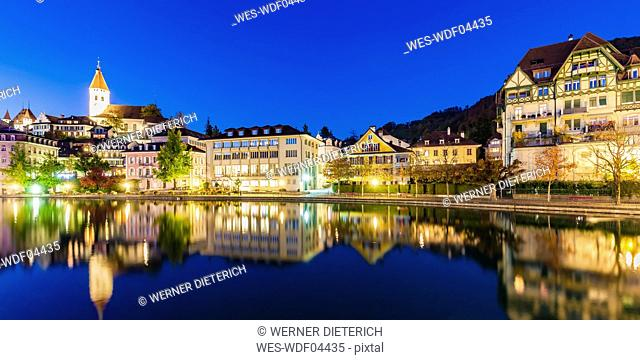 Switzerland, Canton of Bern, Thun, river Aare, old town with parish church and Aarequai at blue hour