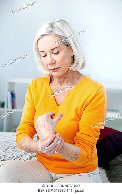 Senior woman with wrist pain