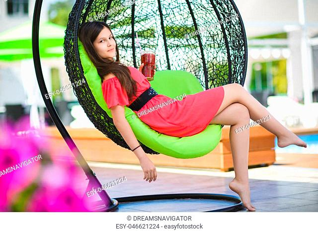pretty teenage girl relaxing on a lounger outdoors