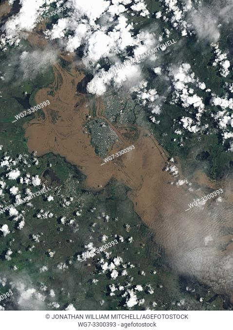 AUSTRALIA Rockhampton -- 09 Jan 2011 -- The airport, Bruce Highway, and large swaths of Rockhampton (visible in the centre of this image) remained underwater on...