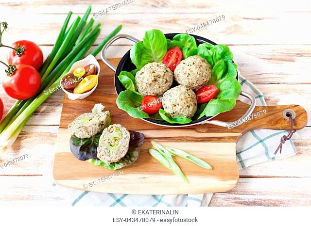 Dietary cutlets cooked in the oven with broccoli served with rissole. On old wooden white background