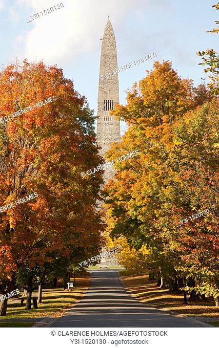 The Bennington Battle Monument and fall foliage along Monument Avenue in Bennington, Vermont, USA