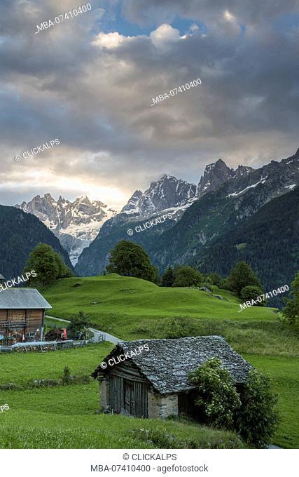Clouds at dawn, Soglio, Bregaglia Valley, Maloja Region, Canton of Graubunden, Switzerland