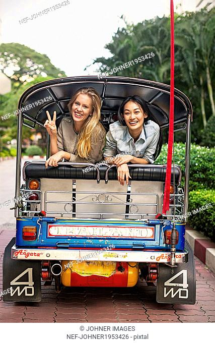 Young women in rickshaw, Bangkok, Thailand