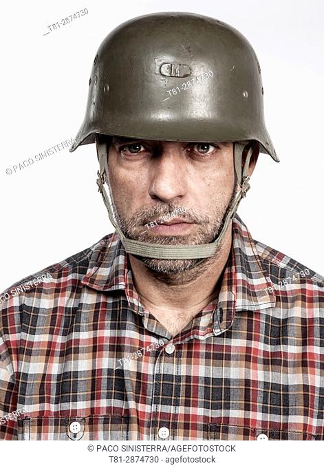 Portrait man with military helmet of the second world war.Valencia