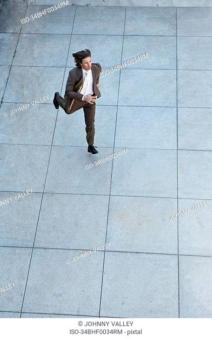 Businessman running in square