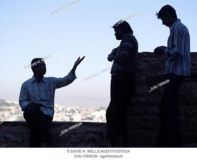 Silhouette of friends talking at fort in Jodhpur, Rajasthan, India