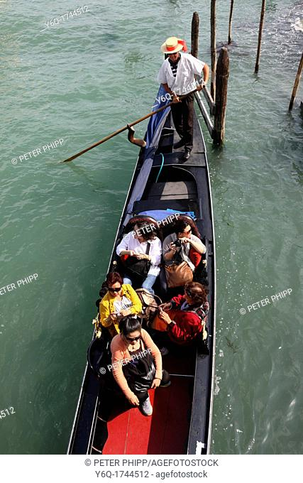People riding in Gondola near San Marco on the Lagoon in Venice  Italy