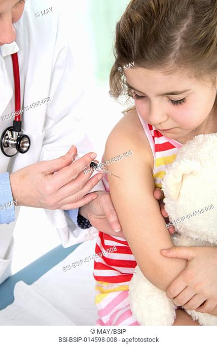 Vaccinating a girl