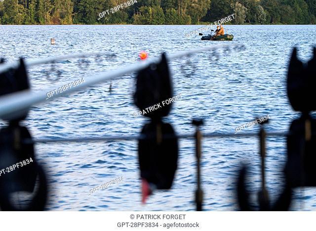 FISHING RODS SET UP BY A LAKE, CARP FISHING, MEZIERES-ECLUIZELLES, EURE-ET-LOIR 28, FRANCE