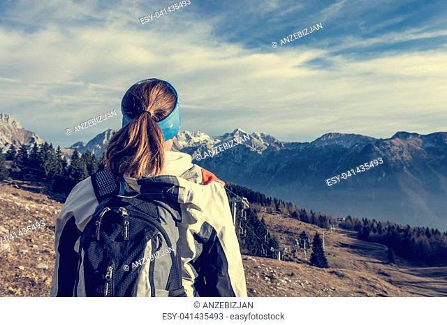 Woman enjoying mountain view. Velika Planina, Slovenia