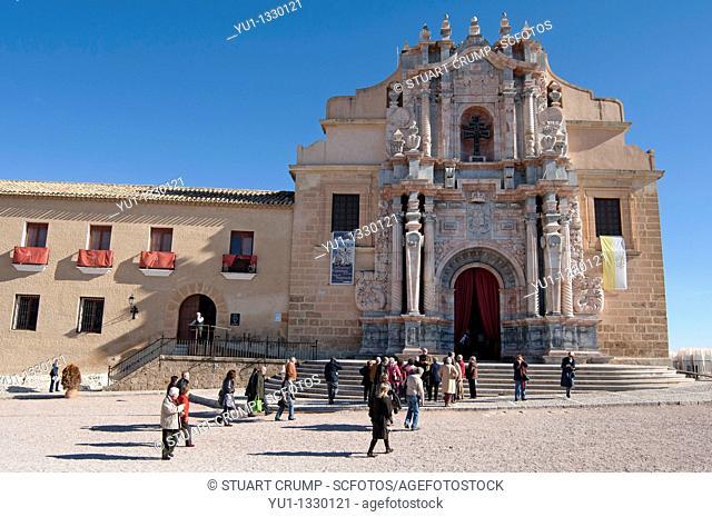 People arrive at the Basilica-Santuario de la Santisma y Vera Cruz within the castle walls at Caravaca de la Cruz, Murcia, Spain