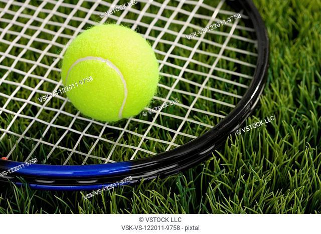 USA, Illinois, Metamora, Tennis ball and tennis racket on grass