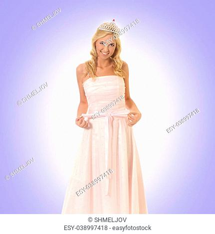 Young beautiful princess over blue background