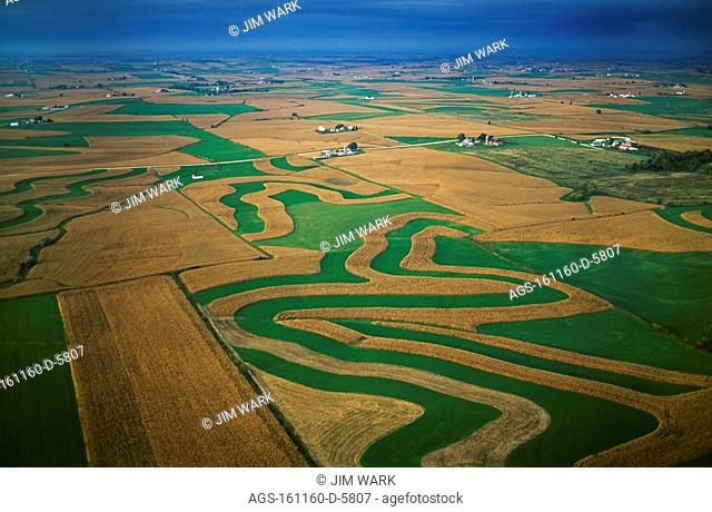 Agriculture - Aerial view of farmsteads and contoured corn and alfalfa fields / WI - Lafayette County