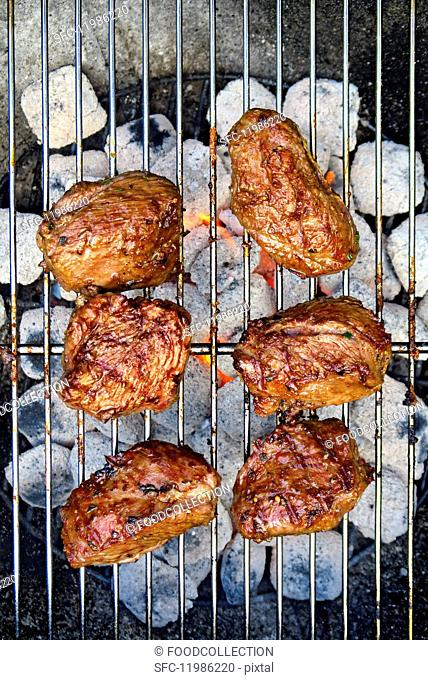 Lamb point steaks on a barbecue