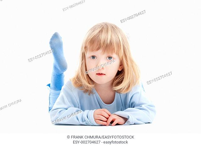 boy with long blond hair on the floor, looking at camera - isolated on white