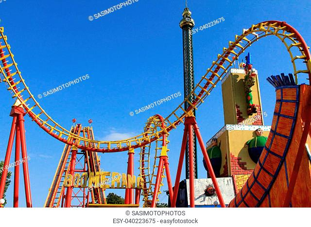 Boomerang - A Roller coaster track in Red and Yellow at Wiener Prater - Prater Amusement Park. The train features Formula One design with the speed of more than...