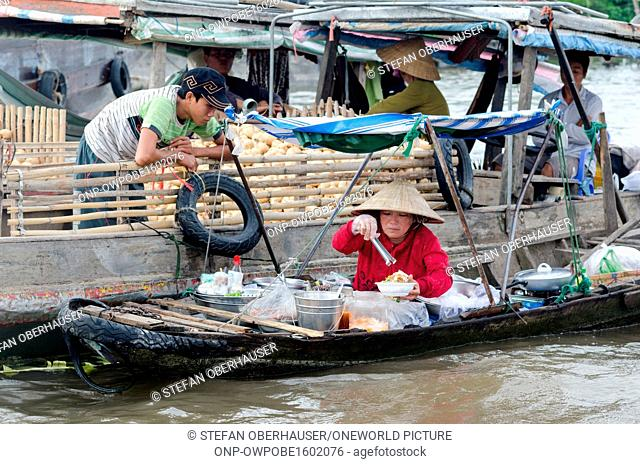 Vietnam, Can Tho, market woman in the floating markets in the Mekong Delta of Vietnam