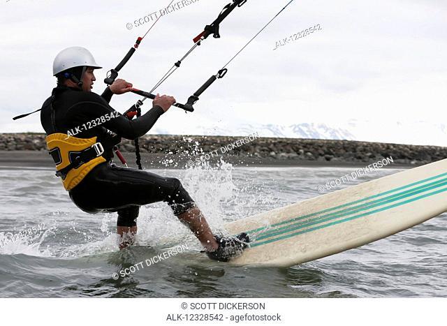 Man kitesurfing in Kachemak Bay, South-central Alaska; Alaska, United States of America