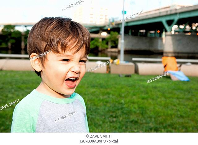 Close up of male toddler making a face