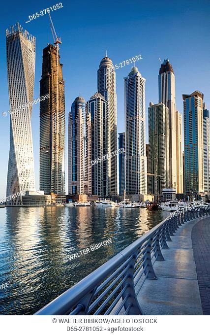 UAE, Dubai, Dubai Marina, high rise buildings including the twisted Cayan Tower, morning