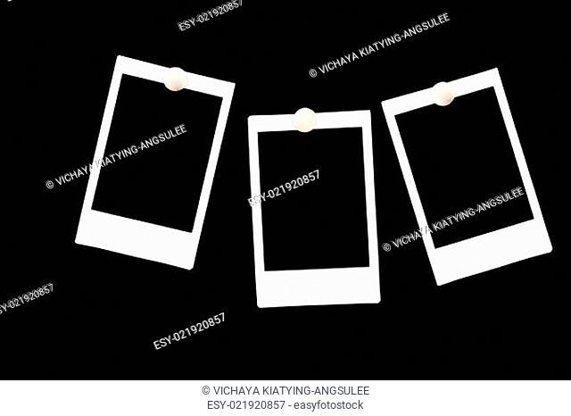 isolated blank polaroids frames on black background