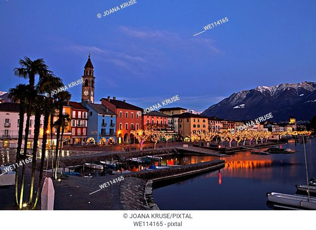 Ascona in the canton of Ticino, Switzerland at Christmas time with illuminated plane trees on the Lungolago