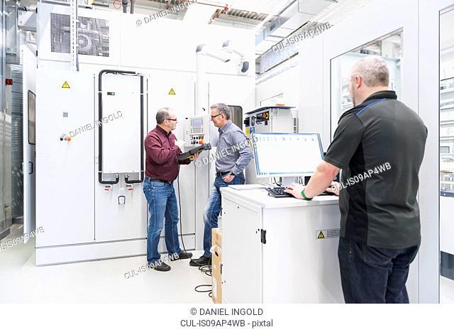 Engineer using computer in factory