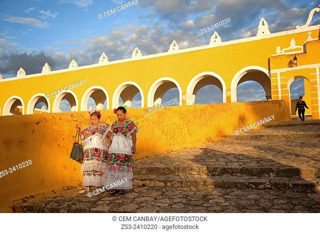 Women with typical Yucatan dress at the stairs of the Monastery, Convent Of San Antonio De Padua, Izamal, Yucatan, Yucatan Province, Mexico, Central America