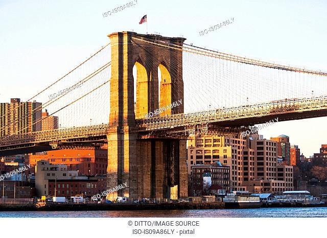 Detail of Brooklyn bridge at sunset New York City, USA