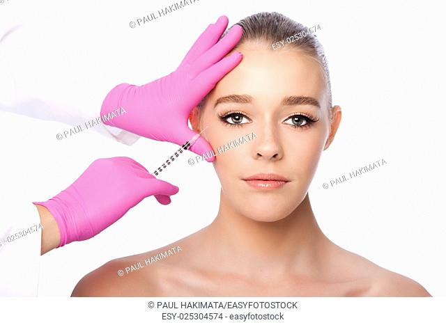 Beautiful face crows feet injection Cosmetic skincare spa beauty treatment with pink gloves by eye, on white