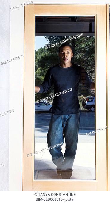 African man standing in doorway