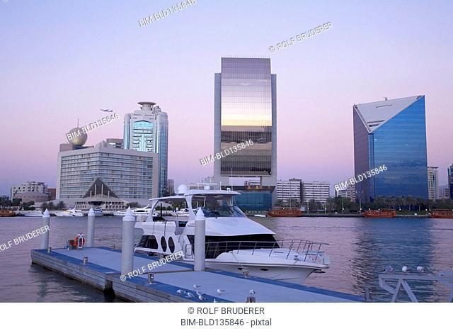 Yacht docked in urban bay, Dubai, United Arab Emirates