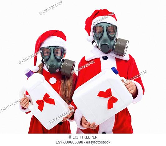 Plastic gifts for christmas - environment concept with kids wearing gas masks