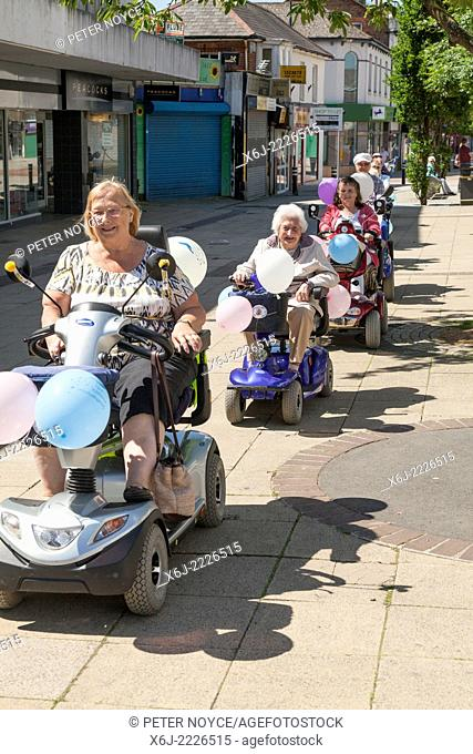 Group of people do a charity fun run in aid of Southampton Hospital on decorated mobility scooters