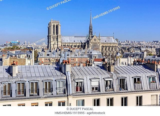 France, Paris, the Notre Dame cathedral on the Ile de la Cite with parisian rooftops