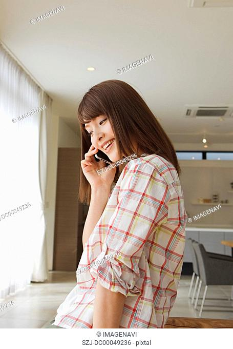 Middle-aged woman talking on a smartphone