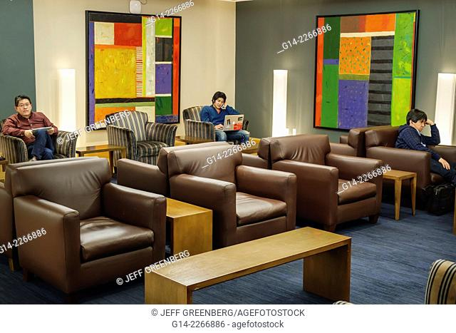 New York, New York, John F. Kennedy International Airport, JFK, terminal, concourse, gate area, American Airlines Ambassador Lounge, seating, Asian, man