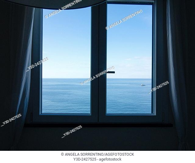 Window with blue sea in background