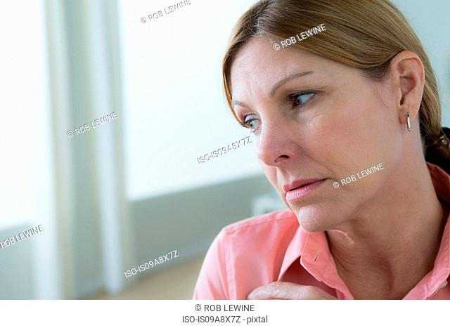 Portrait of sad mature woman looking away
