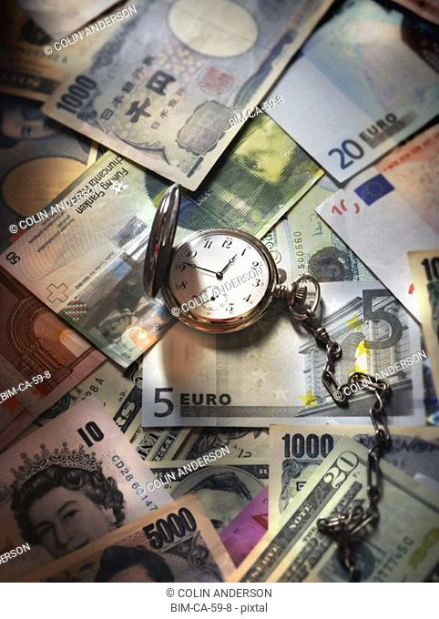Stopwatch on top of world currencies